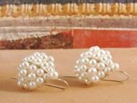 Römische Ohrringe mit Perlenkorb